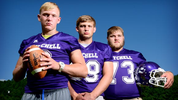 Mitchell football players Ben Young, Alex McKinney and Todd Self.