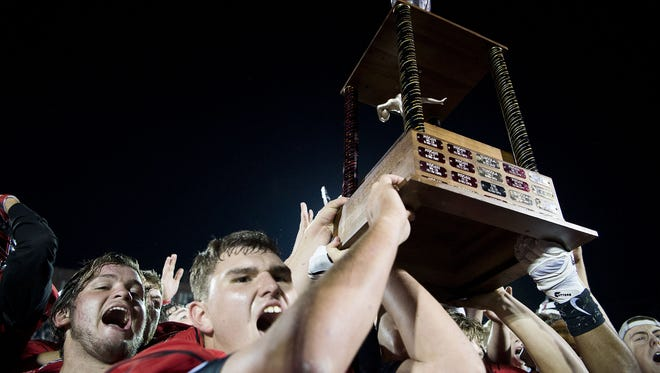 Pisgah football players celebrate after winning Friday's rivalry game over Tuscola.