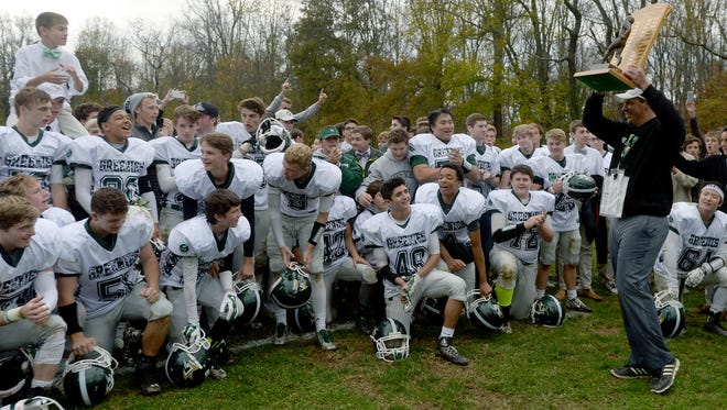 Christ School football coach Mark Moroz has a career record of 55-15.