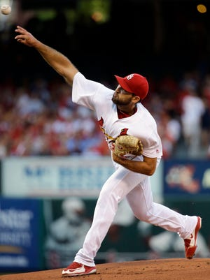 St. Louis Cardinals starting pitcher Michael Wacha throws during the first inning of a baseball game against the Texas Rangers, Friday, June 17, 2016, in St. Louis.