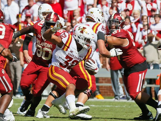 Iowa State running back David Montgomery (32) carries against Oklahoma in the fourth quarter of an NCAA college football game in Norman, Okla., Saturday, Oct. 7, 2017. Iowa State won 38-31. (AP Photo/Sue Ogrocki)