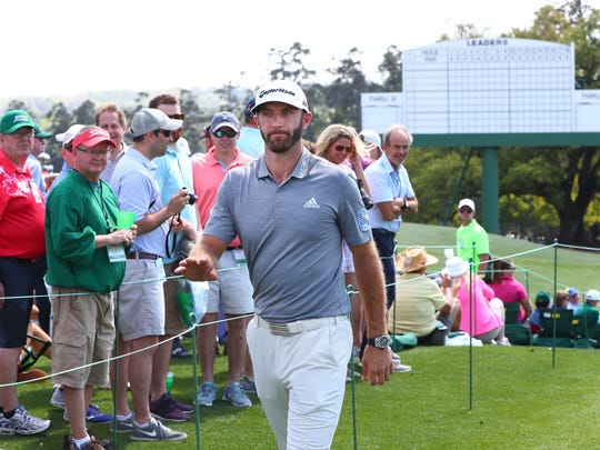 Dustin Johnson heads for the clubhouse after his practice