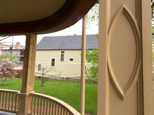 The Sahagian-Allsopps had all the trim pieces removed to restore the original profile of the porch.