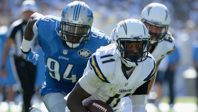 Chargers wide receiver Steve Johnson is pursued by Lions defensive end Ezekiel Ansah at Qualcomm Stadium on Sunday.