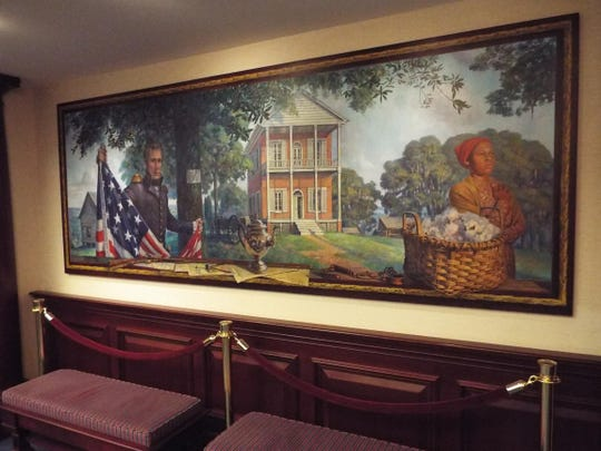 "The mural in the House of Representatives chamber, ""A New Capital,"" depicts the founding of Tallahassee. Among the two dozen historic images in the mural are first territorial Gov. Andrew Jackson, a slave woman and the two-story, first permanent capitol"