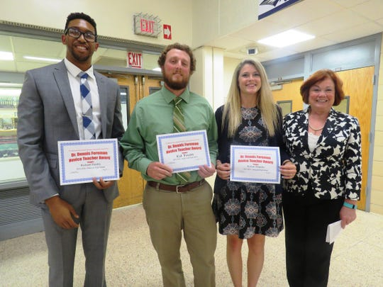 Recipients of the Dr. Dennis Foreman Novice Teacher of the year, from left, Richard Tinsley of Oakcrest High School; Ed Truitt from Cedar Creek High School; Kelsey Schipske from Absegami High School and presenter Alice Foreman.