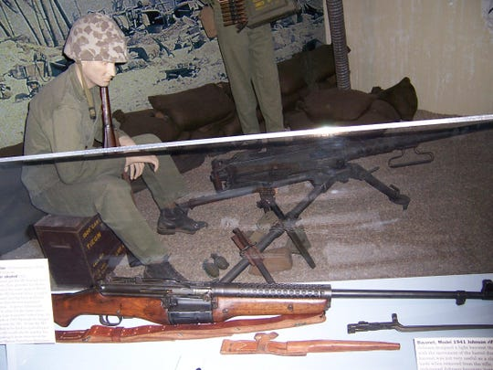 A Marine mannequin sits above a Johnson Rifle, a Johnny Gun, at the Idaho Transportation Museum.