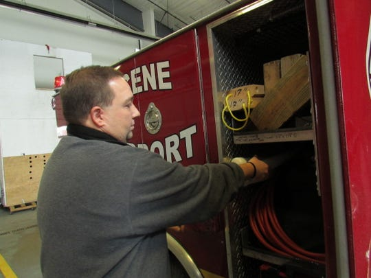 "Coopers Plains Volunteer Fire Department Chief Todd Hall checks equipment in the department's ""collapse and trench"" supplies."