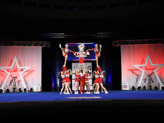 Tioga High School cheerleaders perform at the National