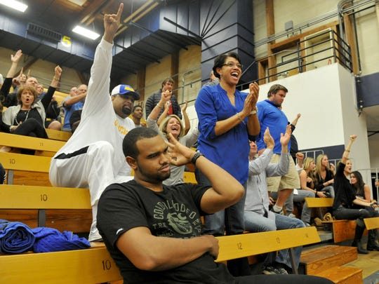 Former Oxnard Police Chief Jeri Williams, right, along with her husband Cody, in back at left, and their son Cody cheer on son Alan during a UC Santa Barbara basketball game in January 2014.