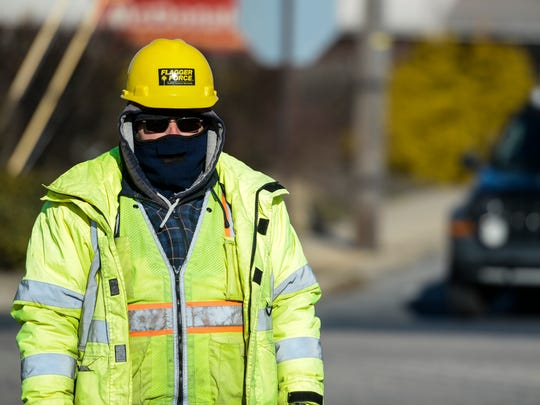 Lorne Koons of Lebanon and a advanced crew leader with Flagger Force was bundled up at East Cumberland and East Walnut streets on Tuesday, January 19, 2016. Koons was wearing thermal underwear, two t-shirts, a flannel jacket, winter jacket, overalls and lots of hands and feet warmers.