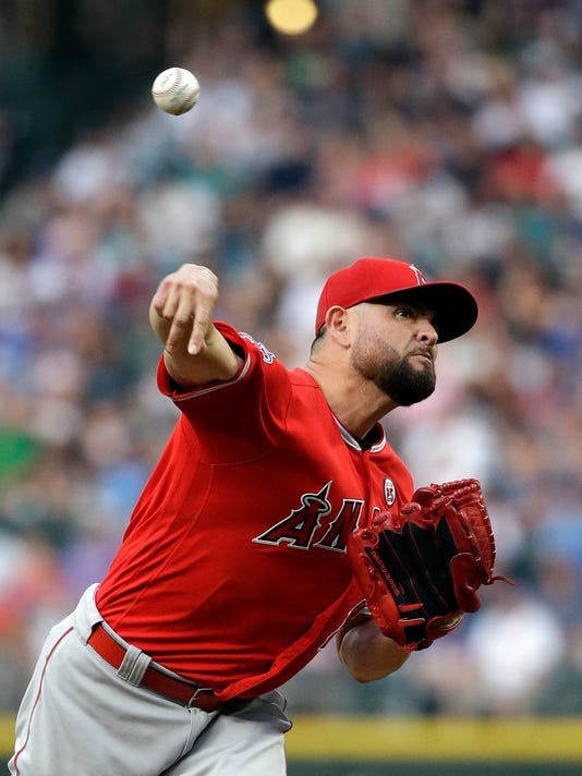 Los Angeles Angels starting pitcher Ricky Nolasco throws against the Seattle Mariners in the first inning of a baseball game Friday, Aug. 11, 2017, in Seattle. (AP Photo/Elaine Thompson)
