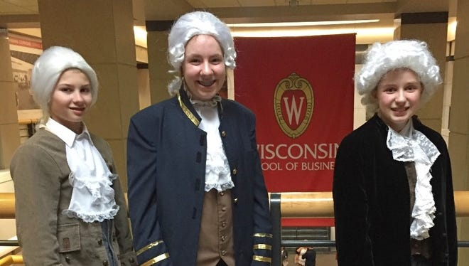 Isaac Geffers (left) as Alexander Hamilton; Elise Liske (center) as George Washington and James Madison; and Avery Doemel (right) as Thomas Jefferson will advance to the National History Day Contest in Washington.
