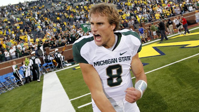 MSU quarterback Kirk Cousins (8) celebrates their 34-17 win in the MSU and UofM football game on Saturday, Oct. 9, 2010, at Michigan Stadium in Ann Arbor