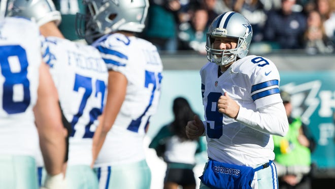 Dallas Cowboys quarterback Tony Romo (9) takes the field against the Philadelphia Eagles during the second quarter at Lincoln Financial Field.