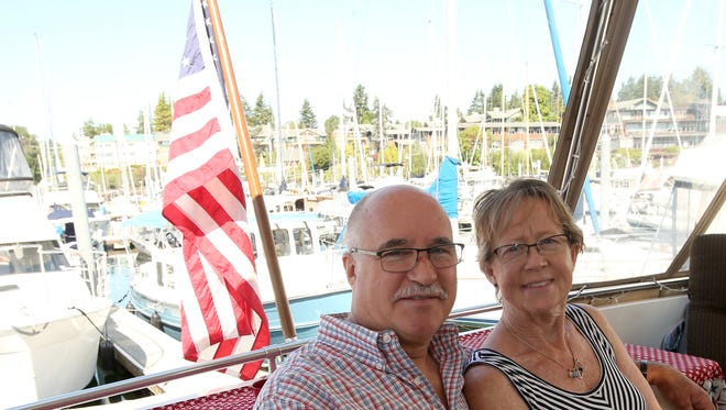 Scott and Laurie Isenman aboard their boat at the Winslow Wharf Marina on Tuesday, June 19, 2018.