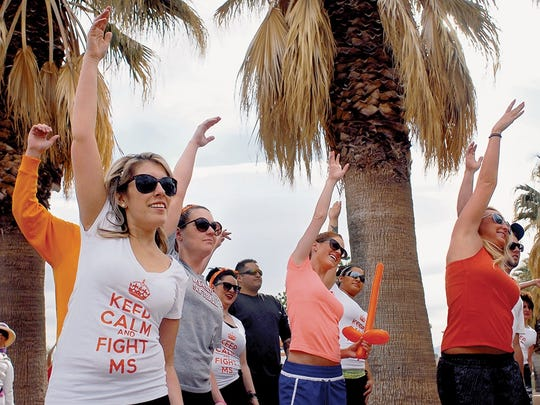 """Amberly Sisneros who battles MS stretches with her team """"Keep Calm and Fight MS"""" at Young Park in this 2013 file photo of Walk MS: Las Cruces."""