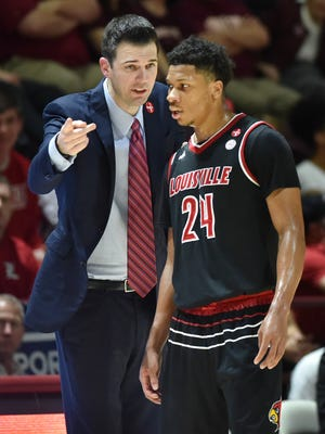 Louisville Cardinals head coach David Padgett speaks with forward Dwayne Sutton (24) during a stoppage in play in the first half against the Virginia Tech Hokies at Cassell Coliseum in Blacksburg, Virginia, on Saturday, Feb. 24, 2018.