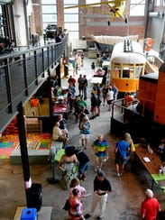 Guests visit brewers' and restaurants' tables at the