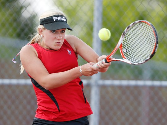 Abney Trout of Lafayette Jeff with a return against Teja Kakani of Harrison at No. 2 singles in the first round of the girls tennis sectional Wednesday, May 18, 2016, at Cumberland Elementary School courts. Harrison sweep Lafayette Jeff 5-0.