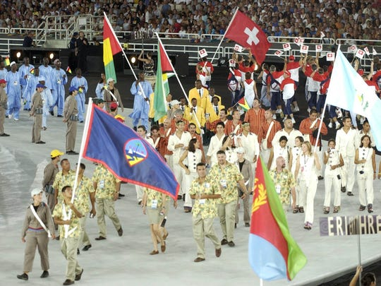 The Guam Olympic team marches into stadium during opening ceremonies for the Athens 2004 Olympic Games.