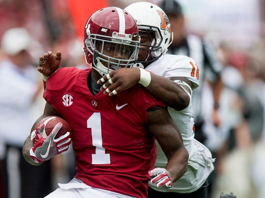 Alabama wide receiver Robert Foster (1) is caught from behind by Mercer linebacker LeMarkus Bailey (16) in first half action at Bryant Denny Stadium in Tuscaloosa, Ala. on Saturday November 18, 2017. (Mickey Welsh / Montgomery Advertiser)