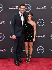 Aaron Rodgers and Danica Patrick arrive at the 2018 ESPYs in Los Angeles.