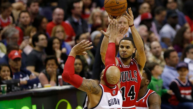 Chicago Bulls guard D.J. Augustin shoots the ball over Washington Wizards forward Drew Gooden in the third quarter at Verizon Center.