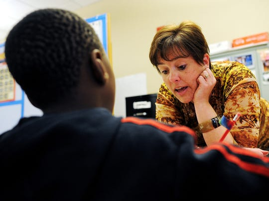 Volunteers like Kristi Worden help Lutheran Social Services and the Sioux Falls Multi-Cultural Center assist refugees resettling in South Dakota with learning the English language and getting access to housing and medical care.