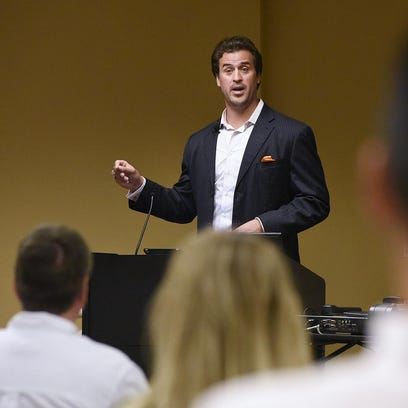 Audience members listen as former NFL player Ben Utecht speaks during a workshop on brain injuries in sports Tuesday at CentraCare Health Plaza in St. Cloud.