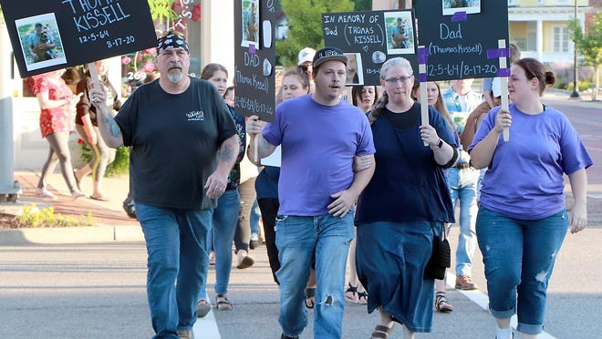 Members of Thomas Kissell's family lead friends and family on a march Thursday from Free Church Park to the Sturgis police station to remember Kissell, 55, who died Aug. 17 following a vehicle-tractor crash.