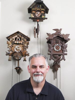 Clock and watch repairman Michael Sater poses with Black Forest hand-carved cuckoo clocks Wednesday, July 13, 2016, in Maryville. Sater recently relocated from Bloomington, Ind., and runs his Tennessee Clock Works business from a home workshop. (PAUL EFIRD/NEWS SENTINEL)