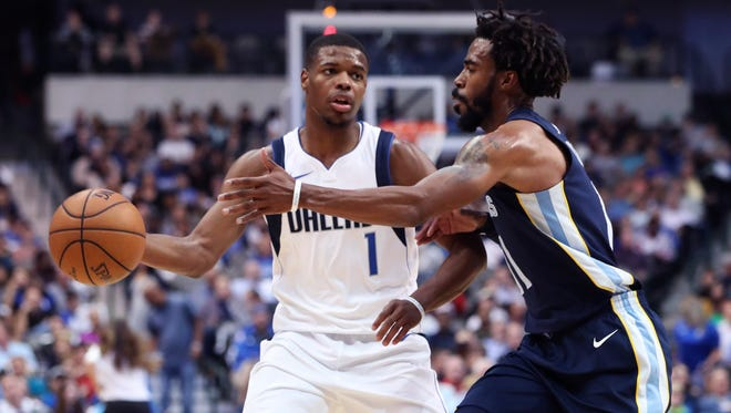 Oct 25, 2017; Dallas, TX, USA; Dallas Mavericks guard Dennis Smith Jr. (1) dribbles as Memphis Grizzlies guard Mike Conley (11) defends during the second half at American Airlines Center.