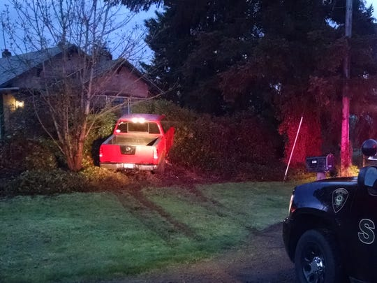 A truck crashed into a fence east of Salem following an early morning burglary Monday.
