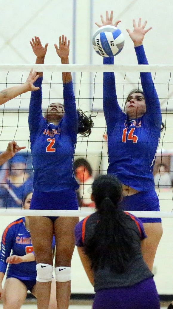 Eliana Arellano, 14, of Canutillo blocks a shot by