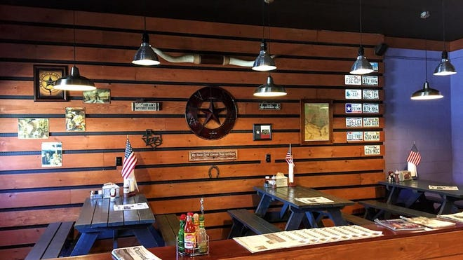 Indoor seating at The Round Up in Cold Spring features a themed interior.