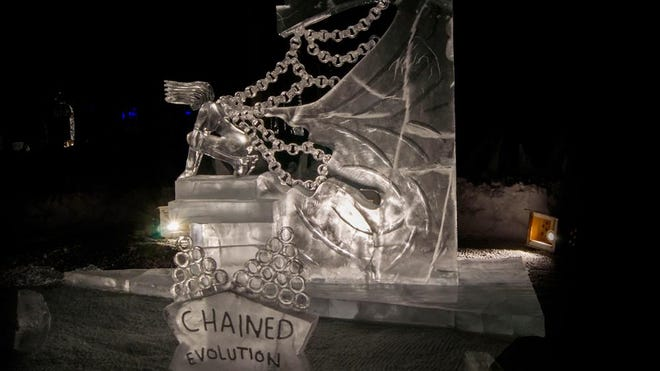 """Brian McKinney of Great Falls and Jeff Kaiser of Pennsylvania are competing in the abstract category at the Ice Alaska world ice sculpturing competition. Their sculpture is named """"Chained Evolution."""""""