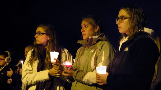 After lighting their candles, students paused for a moment of silence.