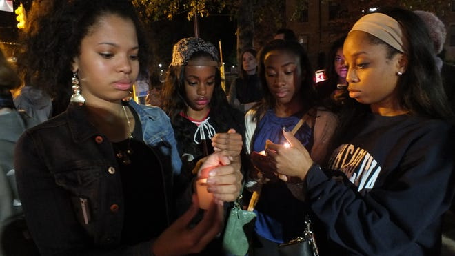 UNC students hold candles in honor of Mike Brown's memory.