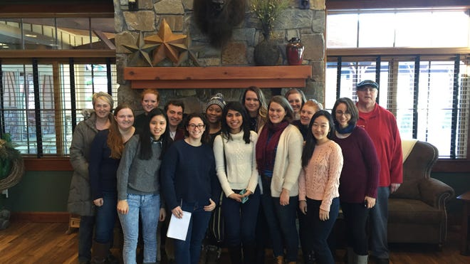 Grinnell College caucus short course students at the Pizza Ranch headquarters.