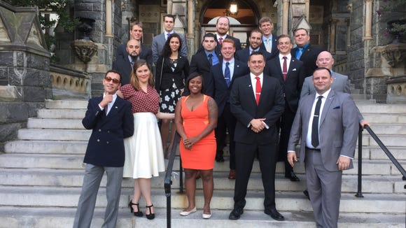 Participants at their final reception at Georgetown University. Henderson is second from the left in the back row, gray suit and purple tie; Starke is second from the left in the front row, red shirt and white skirt.] (Photo Courtesy of Mark Henderson)