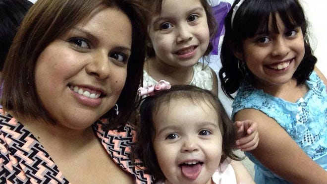 This is a  Facebook photo of Maria Navas and her three daughters.  All four were victims of a fatal shooting Sunday morning in San Carlos Park in an apparent murder-suicide by her live-in boyfriend, Sonny Medina.