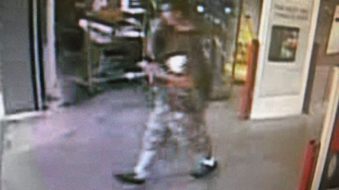 Surveillance image of a man who robbed night vision monoculars and surveillance cameras from a BJ's Wholesale Club