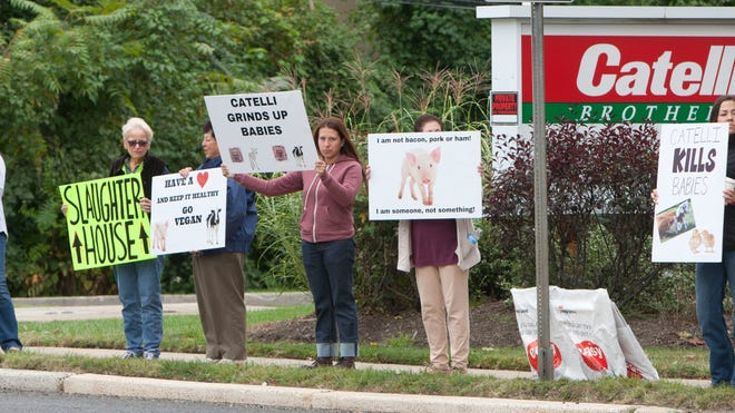 Members of the animal rights group NJ Farm Animals Safe protest outside the Catelli Brothers meat-packing plant in Shrewsbury on Thursday.