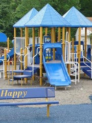 The fully handicap accessible playground behind the
