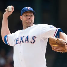 Sep 14, 2014; Arlington, TX, USA; Texas Rangers starting pitcher Colby Lewis (48) pitches against the Atlanta Braves during the first inning at Globe Life Park in Arlington. Mandatory Credit: Jerome Miron-USA TODAY Sports