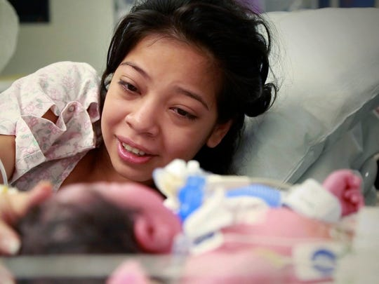 Lesly Leiva with her newborn daughter, Lilly.