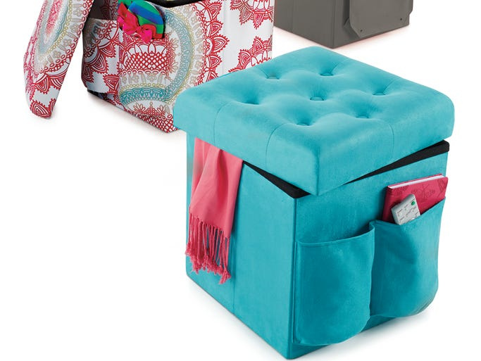 "Transform any seating area with the style and functionality of this Foldable Storage Ottoman. A perfect size for sitting and storing essentials, it is great for any bedroom, living room, or dorm. Handy outside pockets keep certain items within easy reach. Generous interior storage with 2 outside pockets keep essentials within easy reach. Perfect for extra seating and storage. Great for a bedroom, living room, or dorm room. 100% polyester. MDF construction. Measures 15.5"" L x 15.5"" W x 15.5"" H. Maximum weight capacity: 300 lb. Imported. $19.99 each"