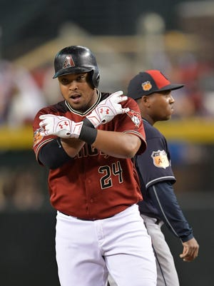 Mar 31, 2017; Phoenix, AZ, USA; Arizona Diamondbacks right fielder Yasmany Tomas (24) reacts after hitting an RBI double against the Cleveland Indians during the fourth inning at Chase Field.