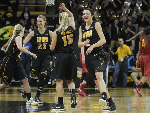 Iowa players celebrate their 76-67 win over Iowa State